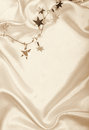 Golden stars and spangles on silk as background in sepia toned can use retro style Stock Photo