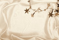 Golden stars and spangles on silk as background in sepia toned can use retro style Stock Images