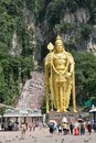 Golden statue of Lord Muragan at the entrance of Batu Caves Hindu Temple near Kuala Lumpur,  Malaysia Royalty Free Stock Photo