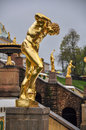 Golden statue of the Peterhof Palace in Saint Petersburg, Russia Royalty Free Stock Photo