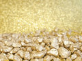 Golden stones and gold abstract background with blurred Royalty Free Stock Photo