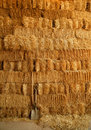 Golden straw bales wall and tools Stock Image