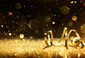 Golden streamers with sparkling glitter ball Stock Photo