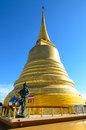 Golden stupa with blue sky in bangkok thailand Royalty Free Stock Photo