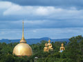 Golden stupa and buddha in forest Stock Photo