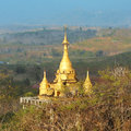 Golden stupa on a hilltop in the countryside kanchanaburi thailand Stock Images