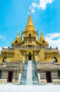 Golden stupa relegion of thailand building on blue sky backgrounds Stock Images