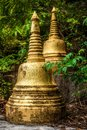 Golden stupas in the jungle