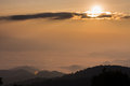 Golden sun rising to the sky over sea of clouds Stock Photography