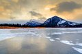 Golden sunrise over vermilion lakes banff national park frozen lake in with mt rundle in the background Stock Photos