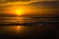 Golden sunrise sunset over the sea ocean waves Stock Photos