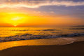 Golden sunrise sunset over the sea ocean waves Stock Images
