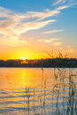 Title: Golden sunset over the lake