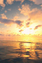 Golden sunset over seascape soft cloudy during hour at oceanic twilight puffy clouds at dawn and gold ocean water reflection of Royalty Free Stock Images