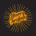 Golden text on black background. Merry Christmas and Happy New Year lettering for invitation and greeting card, prints and posters Royalty Free Stock Photo