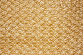 Golden textured oilcloth or leather Royalty Free Stock Photo