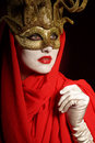 Golden theater mask closeup portrait of sexy woman in for desire concept Royalty Free Stock Photo