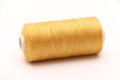 Golden thread to be used in any home sewing project Stock Image