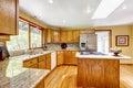 Golden tones kitchen interior with island and skylight mosaic back splash trim washington real estate Stock Image