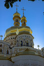 Golden tops of Christian Orthodox Abbey. Vertical Royalty Free Stock Photo