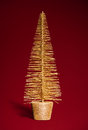 Golden toy christmas tree on red Stock Photos