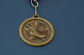 Golden track and field medal one running flying shoe landscape blue background nikon raw file was provided Royalty Free Stock Photography