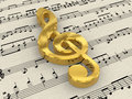 Golden treble clef on score paper Royalty Free Stock Photo