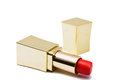 Golden tube of red lipstick isolated on a red background cosmetic product Royalty Free Stock Images