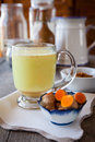 Golden turmeric milk herbal medicine an anti inflammatory shallow dof focus on the brim of the glass and the foam on Royalty Free Stock Photography