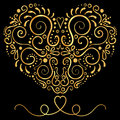 Golden  Vector ornamental floral ornament on the black background. Elegance shape of heart Royalty Free Stock Photo