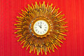 Golden vintage clock on the red wall Royalty Free Stock Photography
