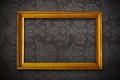 Golden vintage empty frame on floral wallpaper dark Royalty Free Stock Image