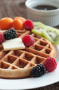 Golden waffle from scratch with fresh fruit Stock Images