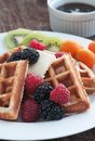 Golden waffle from scratch with fresh fruit Royalty Free Stock Photos