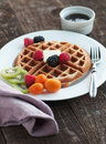 Golden waffle from scratch with fresh fruit Stock Photography