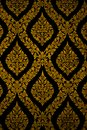 Golden wall thai style. Royalty Free Stock Photos