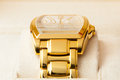 Golden watch on soft holder Royalty Free Stock Photography