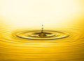 Golden water drop Royalty Free Stock Photo