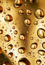 Golden water drops background Royalty Free Stock Images