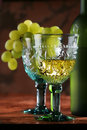 Golden wine in old-time goblet Stock Image