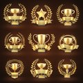 Golden winner trophy cups, prize sports awards with golden wreaths and ribbons Royalty Free Stock Photo