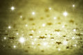 Golden winter background with stars Royalty Free Stock Photo