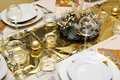 Golden Xmas table setting Stock Photos