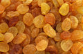 Golden yellow raisins background Stock Images