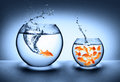 Goldfish jumping improvement concept on blue Royalty Free Stock Photography
