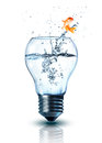 Goldfish jumping out electric bulb Royalty Free Stock Photo