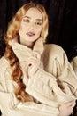 Goldilocks fashion shot of a beautiful lady in a luxurious fur clothing Stock Photos