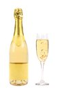 Goldish bottle and glass of champagne. Royalty Free Stock Photo