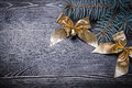 Goldish bows fir tree branch on wooden board holiday concept Stock Photos