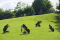 Golf bag caddy carrier motorcycle four nobody course Royalty Free Stock Photo